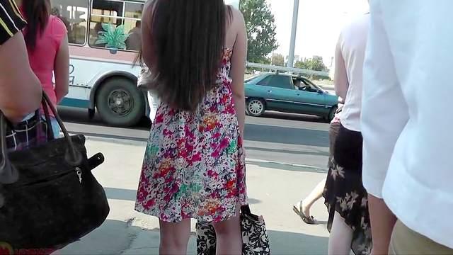 Slender brunette with nice dress gets and upskirt