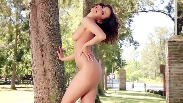 Smiling brunette with a sexy body gets naked