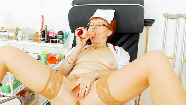 Granny nurse shows her wide snatch