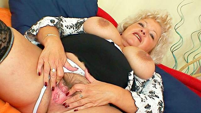 Fat granny with big tits puts dark dildo in her hairy pussy