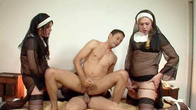 Shemale nuns in stockings have group sex with a guy