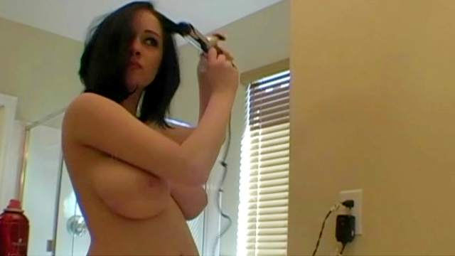 Amateur brunette with big tits gets wet in the bathroom