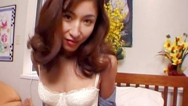 Asian cutie with full lips suck a finger
