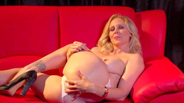 Blonde milf with big tits plays with her smooth snatch