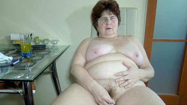 Fat granny Hana shows her naked vagina