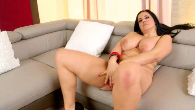 Roxana is touching her big boobies and puss