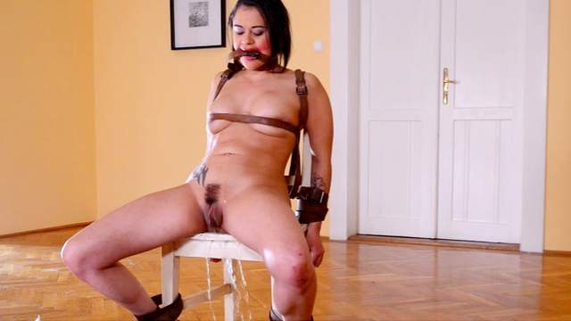Close-up scene with bonded Alice Axx