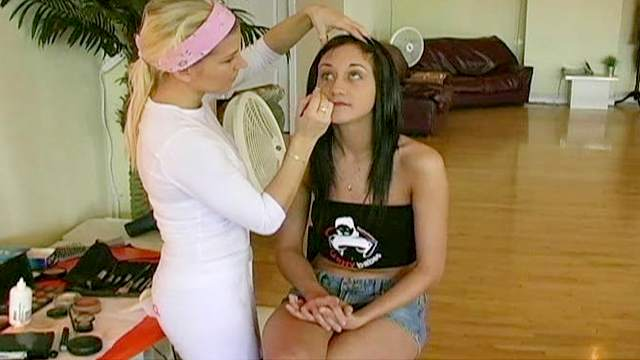 Stunning brunette Izabel is getting a nice makeup