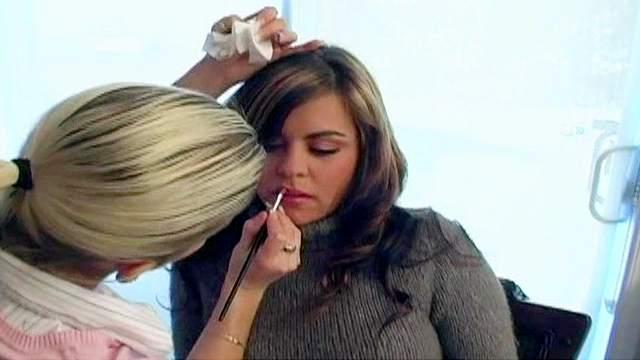 Backstage scene with makeup for Kasey