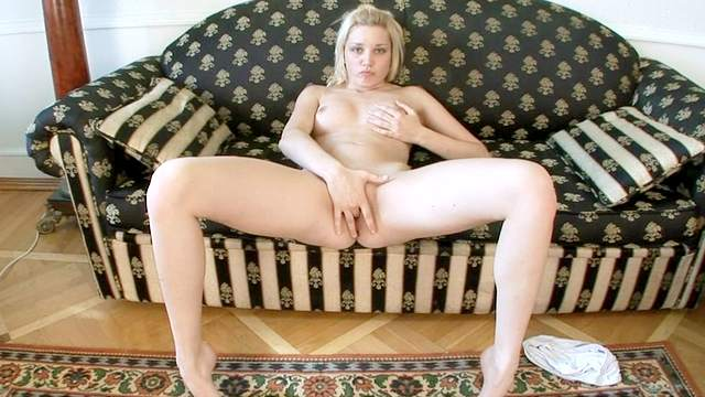 Natural-tit chick Val is touching her pussy