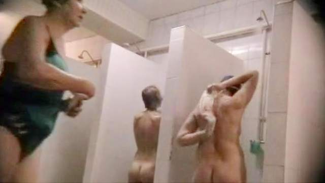 Sexy babes are walking in the public shower