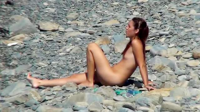 Sweet brunette is showing her tanned shape