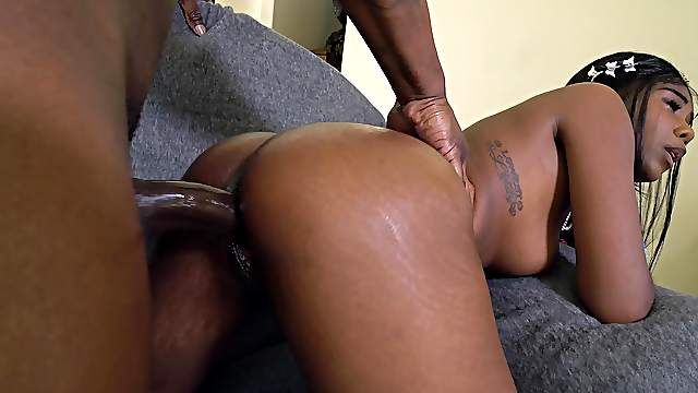 Black chick slides entire BBC up her soaked cunt