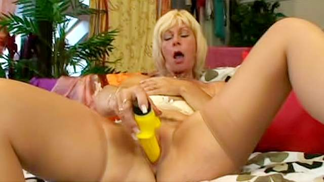 Slutty and nasty Lili is drilling her pussy with yellow dildo
