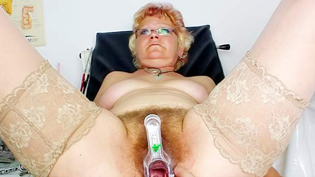 Hairy pussy opens with a speculum