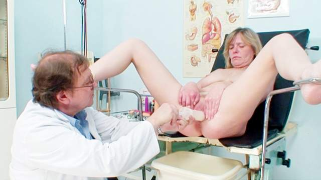 Speculum view inside the mature pussy