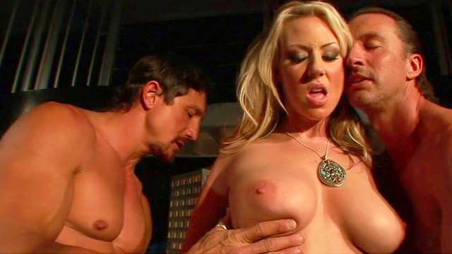 Nasty blonde Carolyn Reese sucks two cocks